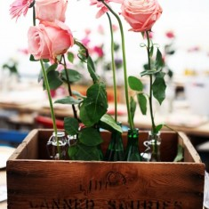 Roses in vintage wooden crate on table