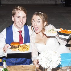 Wedding couple enjoying urban food fest street food