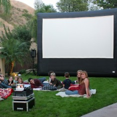 Outdoor cinema screen on the lawn