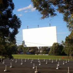 Giant outdoor cinema projection screen in park